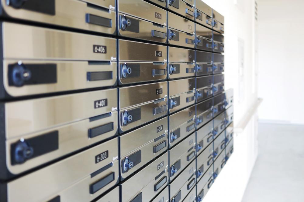 マンション管理標準規約では戸別配布を標準的な対応としている